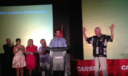 Larry Jefferies (right) accepts the Matthew Orhnstein Lifetime Achievement Award at the 2015 CARSTAR conference.
