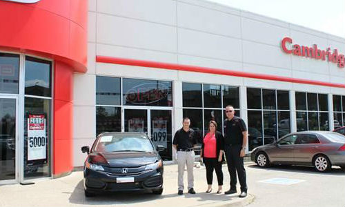 Allen Mattice of CARSTAR Cambridge and Nicole Pereir, General Manager, and Rich Snider, Parts and Service Director, for Cambridge Centre Honda.