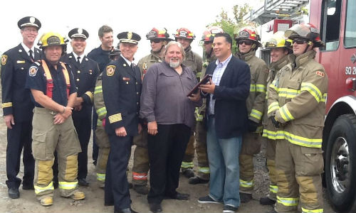 Don Fraser (centre) accepts a plaque honouring his contributions to extrication training for Brampton Fire and Emergency Services.