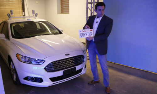 Ford has secured permission to test its autonomous vehicles in California. CEO Mark Fields commemorates the occasion by placing the license plate on an autonomous Fusion Hybrid.