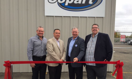 Vinnie Mitz, President of Copart; Steve Macaluso, Managing Director for Copart Canada; Robert Goguen, at the time MP for Moncton—Riverview—Dieppe, and Peter Beers, GM of the Moncton location of Copart, at the new facility's grand opening.