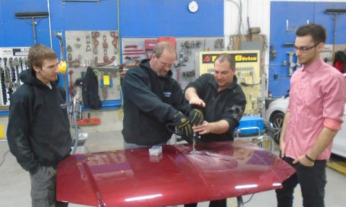 Errol Cowan of Titanium Tools & Equipment (centre) demos the Miracle System for some of the staff at CSN-Carlaw Collision.