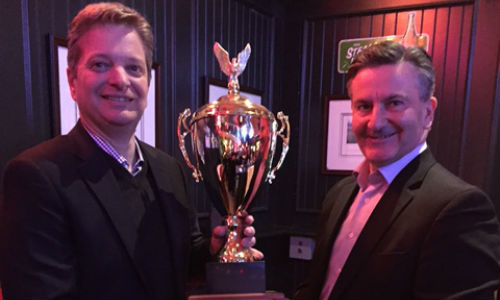 Rick Orser (right) of 3M Canada presents the Rick Berg Award to Pierre Seguin, Sales Executive for Eastern Ontario.