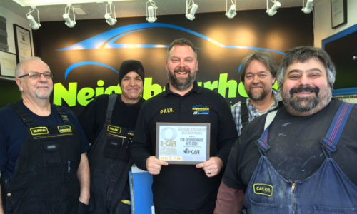 The team at CSN-Neighbourhood Auto Body proudly displays their I-CAR Gold Class certificate.