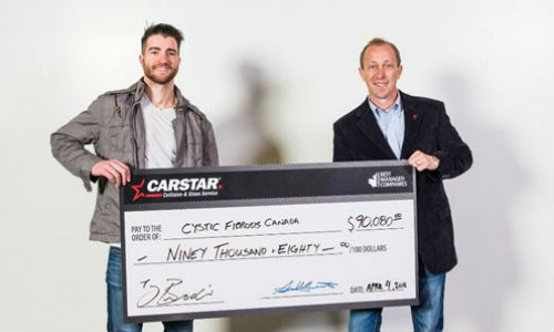 Calgary Flames Defenceman TJ Brodie and Mike Piper, CARSTAR Canada Western Region Director.
