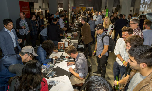 The crowd watches as design contestants engage in a sketch competition at the 2016 Middlecott Sketchbattle Los Angeles presented by BASF.