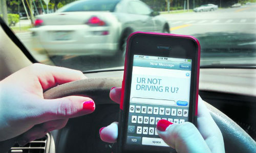 Nearly one-third of Canadians have sent a text while stopped at a red light, according to a recent poll conducted by CAA.