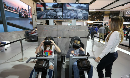 Young AutoShow attendees experience virtual reality (VR) racing at the Lexus display. VR seems to be a large part of this year's offering.