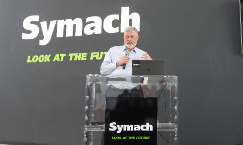 Osvaldo Bergaglio, President of Symach, outlines his company's technology during the Symach factory tour.
