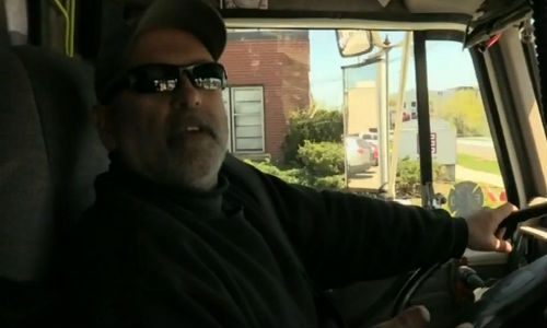 Al Pinheiro at the wheel of his truck, describing to a CTV reporter how he helped police stop Eric Amaral during a gunfight with the police. Photo by CTV News.