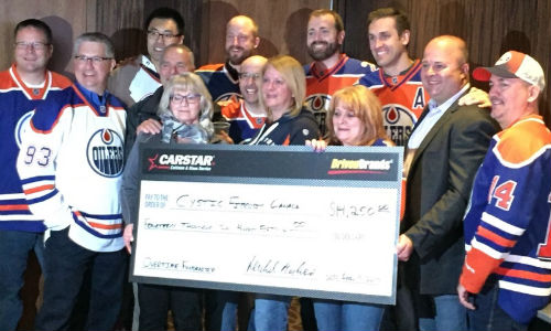 CARSTAR franchise partners, staff and members of the Edmonton Oilers Communication Foundation present the donation to Cystic Fibrosis Canada.