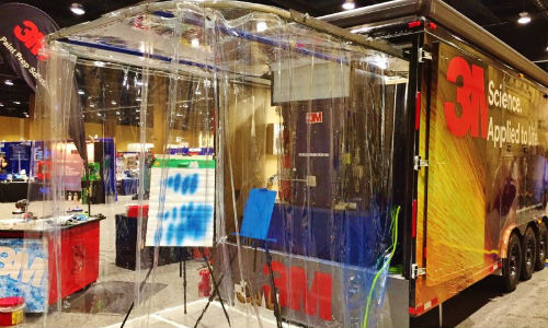The back of the 3M DEMO trailer features a fully functional paint booth. Other parts of the DEMO trailer offer similar functions in regards to different tools, allowing repairers to try out equipment in real applications.