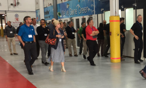 Members of the Coyote Group tour Budds' Collision in Oakville, Ontario. The facility received the Coyote Group Shop of the Year award at the previous meeting in Palm Springs.