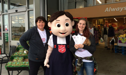 Craftsman Collision staff and Salvation Army mascot Sally Ann at this year's food drive. In total, the event raised $33,944.70 in donations this year.