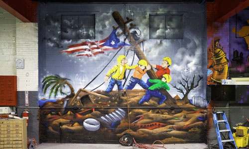 Mike Vargas, the owner of East Coast Customs Automotive Playground, had a huge mural dedicated to the clean-up of Puerto Rico after Hurricane Maria painted on one of the walls.