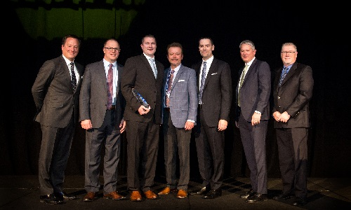 The BBB Industries team accepting their award.