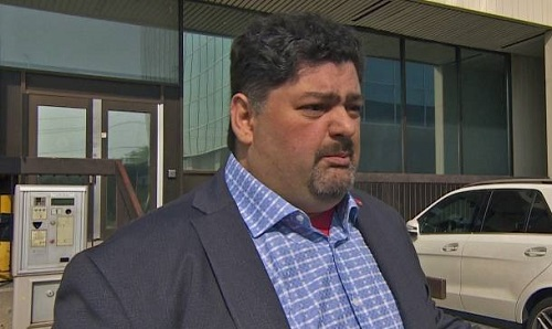 Cos Licursi, the owner of Eugene Collision in Toronto, is arguing Aviva's secret investigation of ten Toronto-based repair facilities is criminal. (Mary Webster/CBC)