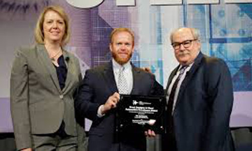 From left to right: Jody Hall, vice president, automotive market for SMDI; Automotive Excellence award recipient, Nic Goldsberry, senior design engineer at Honda and David Anderson, senior director, automotive market, SMDI.