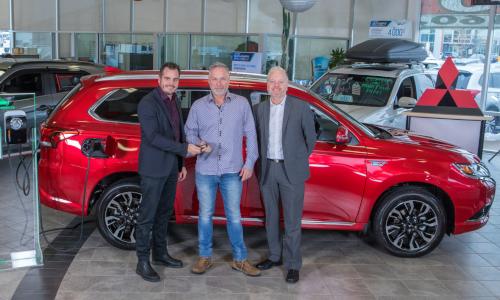Serge McGraw (centre) chose Mitsubishi's Outlander PHEV for its load capacity and its ability to run on 100 per cent electric. He is shown with (left) François Roy, general manager, Québec Mitsubishi, and Marco Sauvageau, sales director, Québec Mitsubishi. Photo courtesy Mitsubishi Motor Sales of Canada.